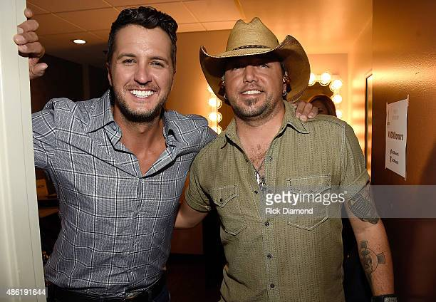 Luke Bryan and Jason Aldean pose backstage during the 9th Annual ACM Honors at the Ryman Auditorium on September 1 2015 in Nashville Tennessee