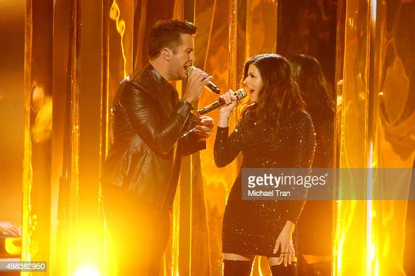 Luke Bryan and Karen Fairchild perform onstage at the 2015 American Music Awards at Microsoft Theater on November 22 2015 in Los Angeles California