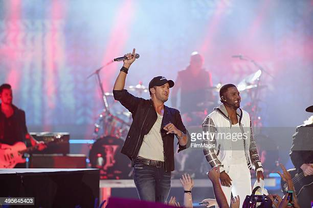 Luke Bryan Jason Derulo perform onstage during the 2014 CMT Music awards at the Bridgestone Arena on June 4 2014 in Nashville Tennessee