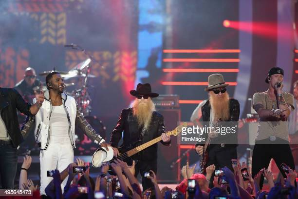 Luke Bryan Jason Derulo ZZ Top perform with Florida Georgia Line perform onstage during the 2014 CMT Music awards at the Bridgestone Arena on June 4...