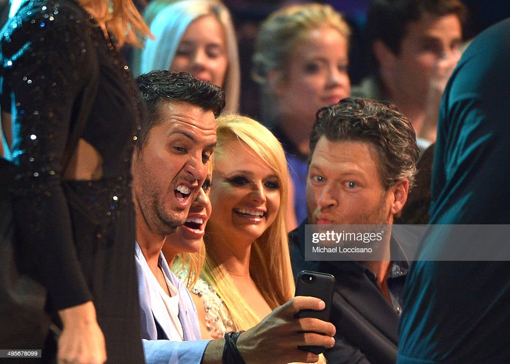 <a gi-track='captionPersonalityLinkClicked' href=/galleries/search?phrase=Luke+Bryan&family=editorial&specificpeople=4001956 ng-click='$event.stopPropagation()'>Luke Bryan</a>, <a gi-track='captionPersonalityLinkClicked' href=/galleries/search?phrase=Miranda+Lambert&family=editorial&specificpeople=571972 ng-click='$event.stopPropagation()'>Miranda Lambert</a> and <a gi-track='captionPersonalityLinkClicked' href=/galleries/search?phrase=Blake+Shelton&family=editorial&specificpeople=2352026 ng-click='$event.stopPropagation()'>Blake Shelton</a> attend the 2014 CMT Music Awards at Bridgestone Arena on June 4, 2014 in Nashville, Tennessee.
