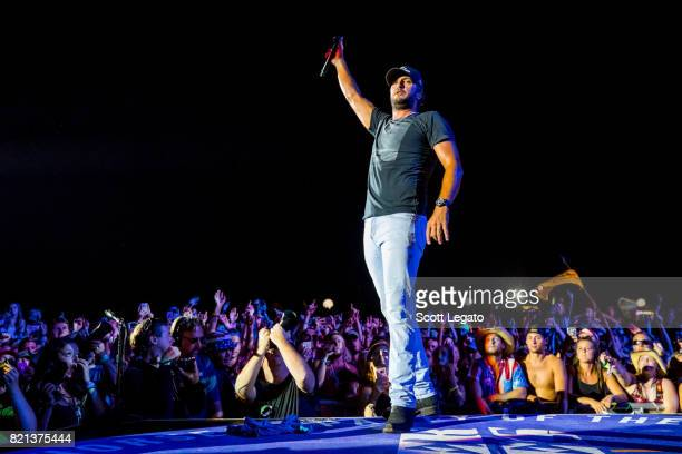 Luke Bryan performs during day 3 of Faster Horses Festival at Michigan International Speedway on July 23 2017 in Brooklyn Michigan