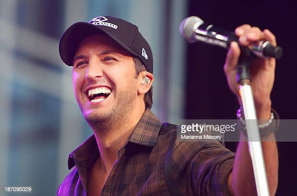 Luke Bryan performs on ABC's 'Good Morning America' outside of the Bridgestone Arena ahead of the CMA Awards on November 6 2013 in Nashville Tennessee