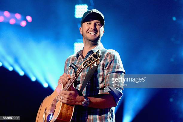 Luke Bryan performs onstage during the 2016 CMT Music awards at the Bridgestone Arena on June 8 2016 in Nashville Tennessee