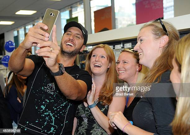 Luke Bryan takes a selfie with fans using the new Galaxy S6 edge at Best Buy in York to celebrate the unveiling of Samsung's newest devices the...