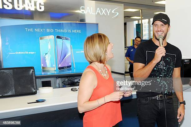 Luke Bryan takes a selfie with fans using the new Galaxy S6 edge at Best Buyin York to celebrate the unveiling of Samsung's newest devices the...