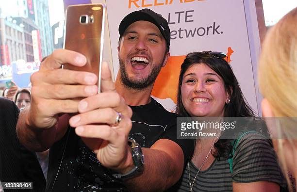 Luke Bryan takes a selfie with fans using the new Galaxy S6 edge at the ATT store in New York to celebrate the unveiling of Samsung's newest devices...
