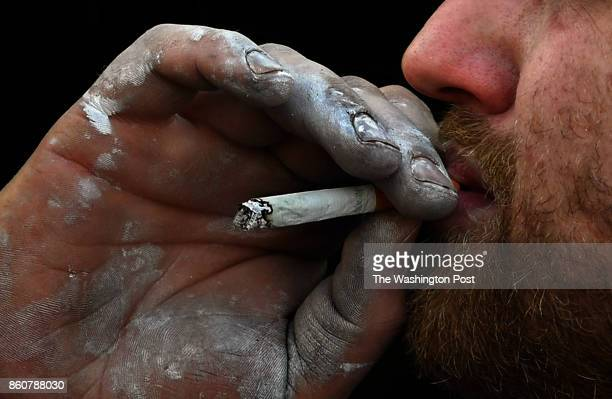 Luke Buckingham with his workingmanhands takes a drag off of a cigarette during a beak in class We followed some participants in an immersion...