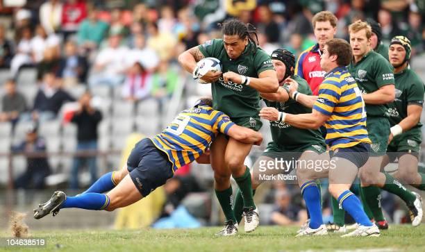 Luke Burgess of Sydney Uni tackles John Tamanika of Randwick during the Shute Shield Grand Final match between Randwick and Sydney University at...