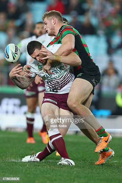 Luke Burgess of the Eagles is tackled by George Burgess of the Rabbitohs during the round 16 NRL match between the South Sydney Rabbitohs and the...
