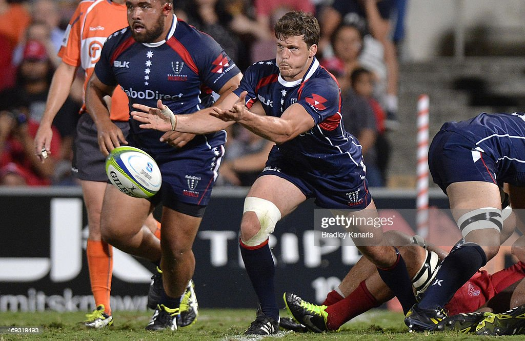 Luke Burgess of the Rebels passes the ball during the Super Rugby trial match between the Queensland Reds and the Melbourne Rebels at Ballymore Stadium on February 14, 2014 in Brisbane, Australia.