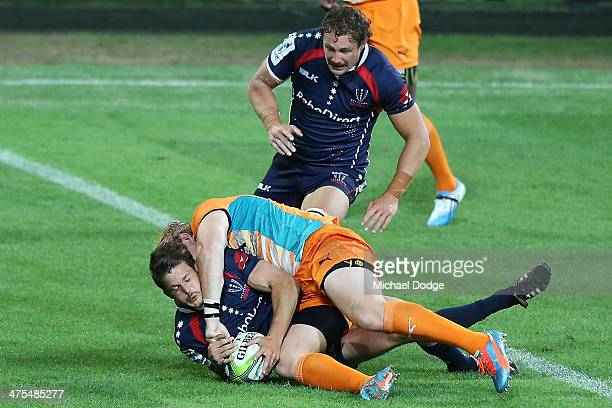 Luke Burgess of the Rebels scores a try during the round three Super Rugby match between the Melbourne Rebels and the Cheetahs at AAMI Park on...