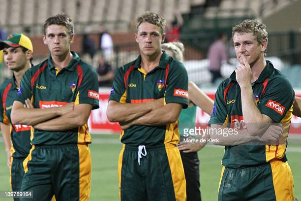 Luke Butterworth and George Bailey of Tasmania after the 2012 Ryobi One Day Cup final match between the South Australia Redbacks and the Tasmania...
