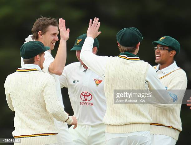 Luke Butterworth of Tasmania is congratulated by Clive Rose and his teammates after dismissing Kelvin Smith of South Australia during the Futures...