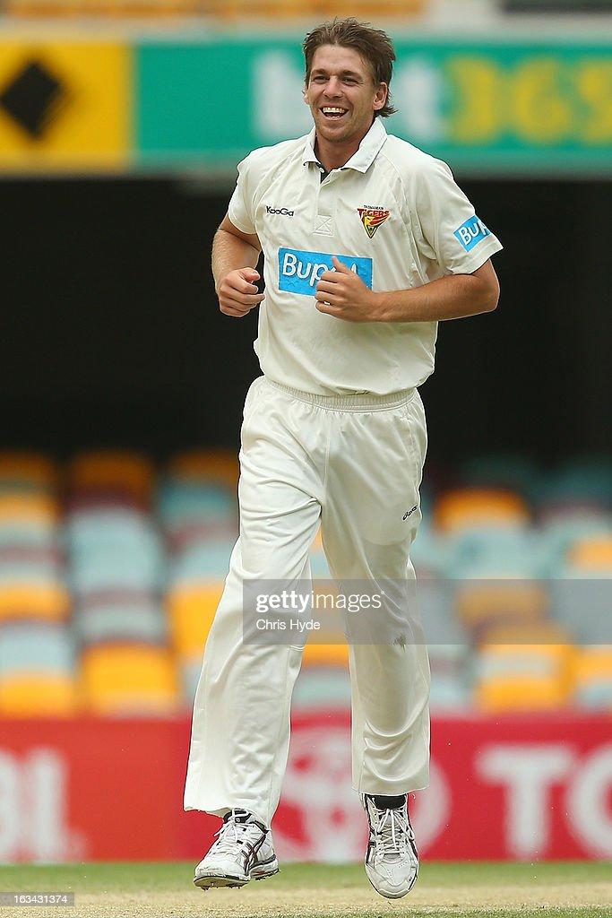 Luke Butterworth of the Tigers celebrates after dismissing Greg Moller of the Bulls during day four of the Sheffield Shield match between the Queensland Bulls and the Tasmanian Tigers at The Gabba on March 10, 2013 in Brisbane, Australia.