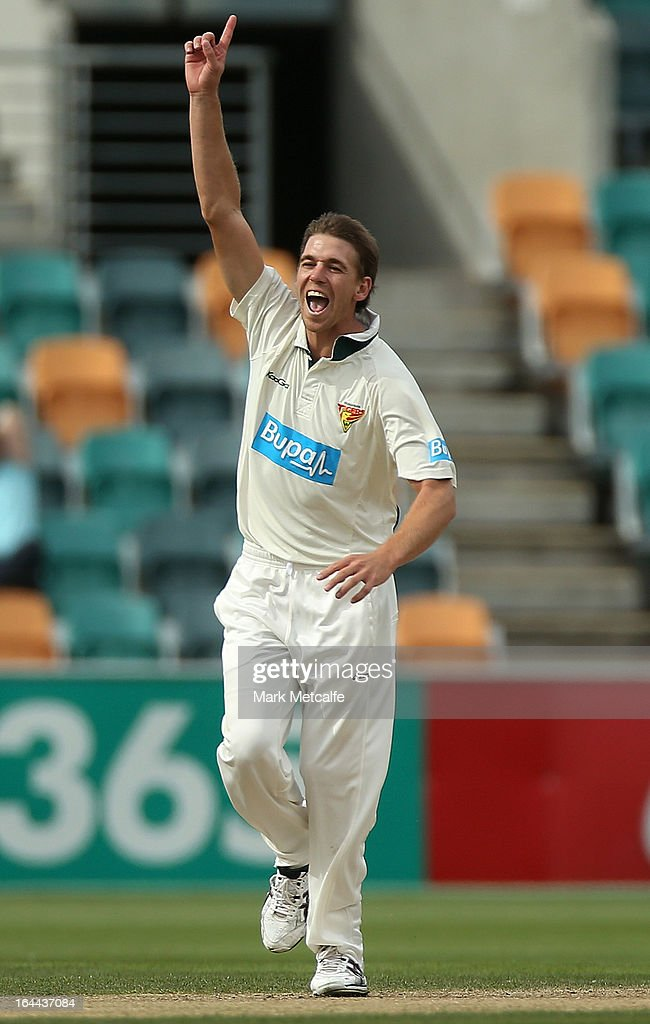 Luke Butterworth of the Tigers celebrates taking the wicket of Luke Pomersbach of the Bulls during day three of the Sheffield Shield final between the Tasmania Tigers and the Queensland Bulls at Blundstone Arena on March 24, 2013 in Hobart, Australia.