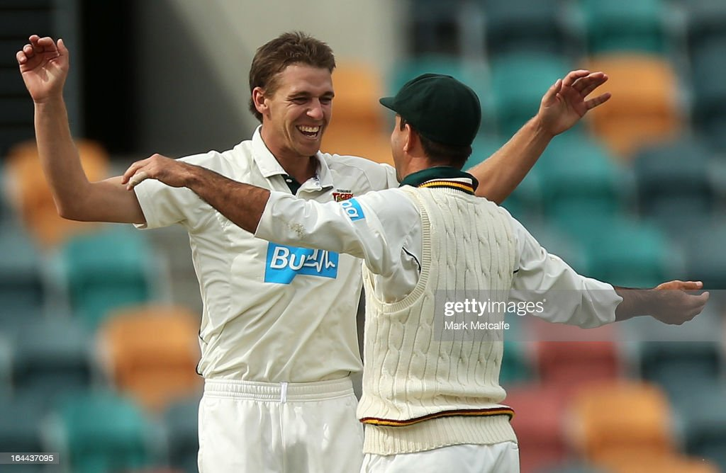 Luke Butterworth of the Tigers celebrates with Ricky Ponting after taking the wicket of Luke Pomersbach of the Bulls during day three of the Sheffield Shield final between the Tasmania Tigers and the Queensland Bulls at Blundstone Arena on March 24, 2013 in Hobart, Australia.