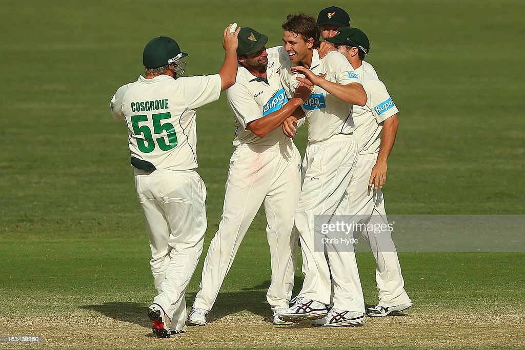 Luke Butterworth of the Tigers celebrates with team mates after dismissing Chris Hartley of the Bulls during day four of the Sheffield Shield match between the Queensland Bulls and the Tasmanian Tigers at The Gabba on March 10, 2013 in Brisbane, Australia.