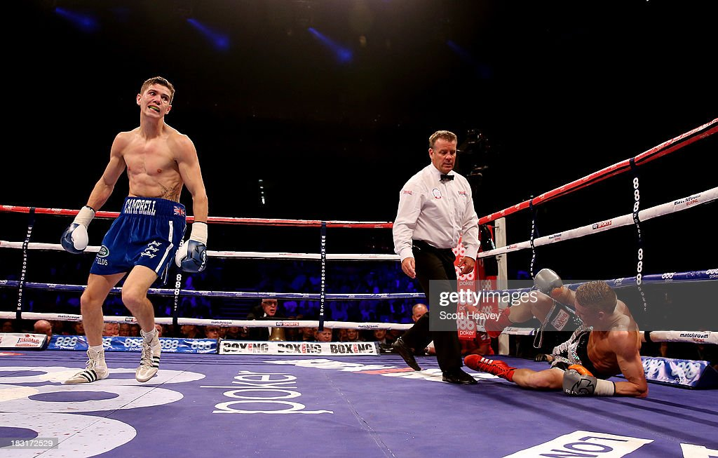 Luke Campbell knocks down Neil Hepper during their Lightweight bout at O2 Arena on October 5, 2013 in London, England.