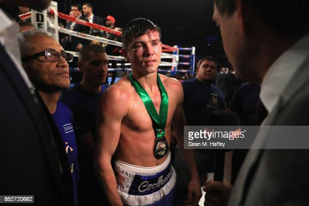 Luke Campbell of Great Britain speaks with the media after being defeated by Jorge Linares of Venezuela in their WBA lightweight title bout at The...