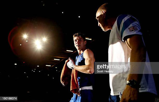 Luke Campbell of Great Britain walks out of the ring with his coach after defeating John Joe Nevin of Ireland to win the Men's Bantam Boxing final...