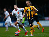 Luke Chadwick of Cambridge moves away from Jake Howells of Luton during the FA Cup Third Round match between Cambridge United and Luton Town at the...