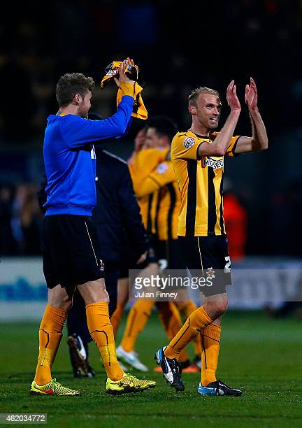 Luke Chadwick of Cambridge United applauds the fans after the FA Cup Fourth Round match between Cambridge United and Manchester United at The R...
