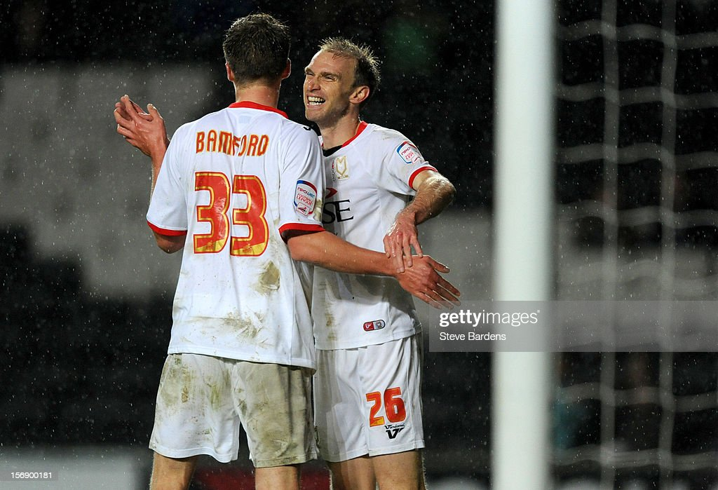 <a gi-track='captionPersonalityLinkClicked' href=/galleries/search?phrase=Luke+Chadwick&family=editorial&specificpeople=241517 ng-click='$event.stopPropagation()'>Luke Chadwick</a> of MK Dons celebrates scoring his second goal with Patrick Bamford during the npower League One match between MK Dons and Colchester United at Stadium MK on November 24, 2012 in Milton Keynes, England.