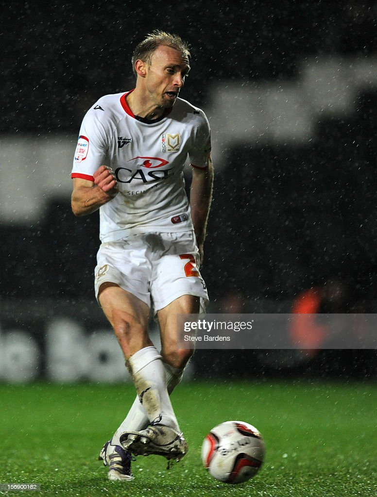 <a gi-track='captionPersonalityLinkClicked' href=/galleries/search?phrase=Luke+Chadwick&family=editorial&specificpeople=241517 ng-click='$event.stopPropagation()'>Luke Chadwick</a> of MK Dons scores his second goal during the npower League One match between MK Dons and Colchester United at Stadium MK on November 24, 2012 in Milton Keynes, England.