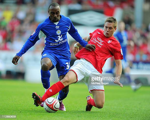Luke Chambers of Forest tackles Darius Vassell of Leicester during the npower Championship match between Nottingham Forest and Leicester City at the...