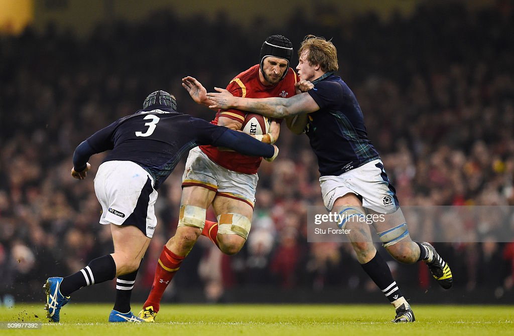 <a gi-track='captionPersonalityLinkClicked' href=/galleries/search?phrase=Luke+Charteris&family=editorial&specificpeople=2200857 ng-click='$event.stopPropagation()'>Luke Charteris</a> of Wales is tackled by WP Nel and Jonny Gray of Scotland during the RBS Six Nations match between Wales and Scotland at the Principality Stadium on February 13, 2016 in Cardiff, Wales.