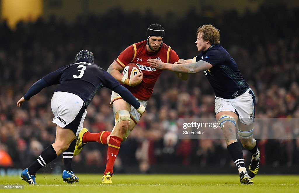 Luke Charteris of Wales is tackled by WP Nel and Jonny Gray of Scotland during the RBS Six Nations match between Wales and Scotland at the Principality Stadium on February 13, 2016 in Cardiff, Wales.