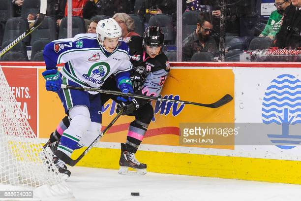 Luke Coleman of the Calgary Hitmen battles for the puck against Noah King of the Swift Current Broncos during a WHL game at the Scotiabank Saddledome...