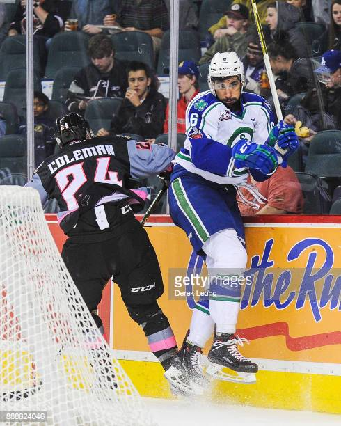 Luke Coleman of the Calgary Hitmen checks Sahvan Khaira of the Swift Current Broncos during a WHL game at the Scotiabank Saddledome on December 8...