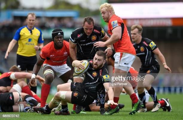 Luke CowanDickie of Exeter Chiefs goes to ground during the Aviva Premiership semi final match between Exeter Chiefs and Saracens at Sandy Park on...