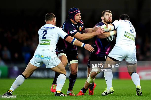 Luke CowanDickie of Exeter Chiefs is tackled by Davit Zirakshvili of ASM Clermont Auvergne during the European Rugby Champions Cup match between...