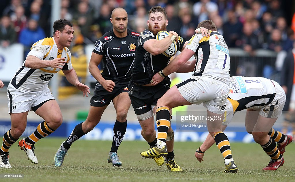 Luke Cowan-Dickie of Exeter is tackled by <a gi-track='captionPersonalityLinkClicked' href=/galleries/search?phrase=Matt+Mullan+-+Rugby+Player&family=editorial&specificpeople=705828 ng-click='$event.stopPropagation()'>Matt Mullan</a> (R) and George Smith during the Aviva Premiership match between Exeter Chiefs and Wasps at Sandy Park on May 1, 2016 in Exeter, England.