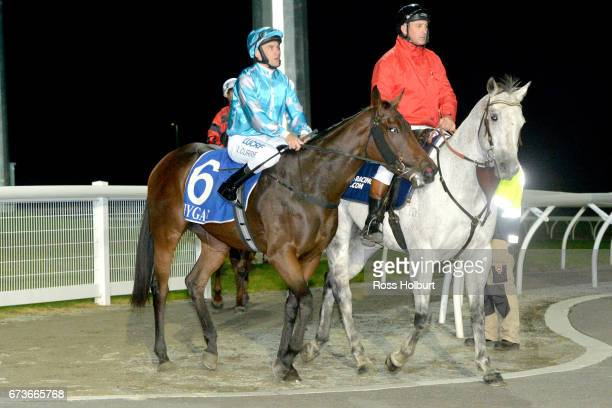Luke Currie returns to the mounting yard on Let 'em Howl after winning the XXXX Gold FM Maiden Plate at Racingcom Park Synthetic Racecourse on April...