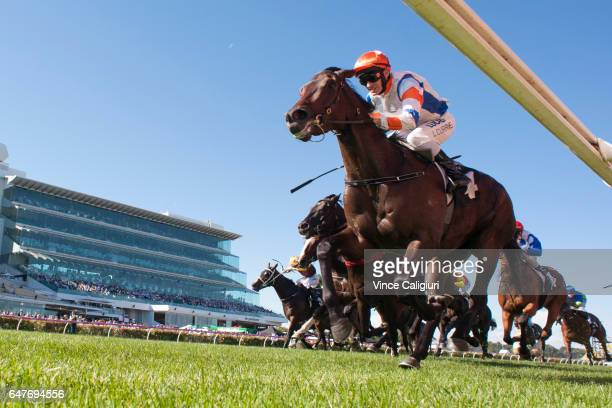 Luke Currie riding Hey Doc winning Race 7 Australian Guineas during Melbourne Racing at Flemington Racecourse on March 4 2017 in Melbourne Australia