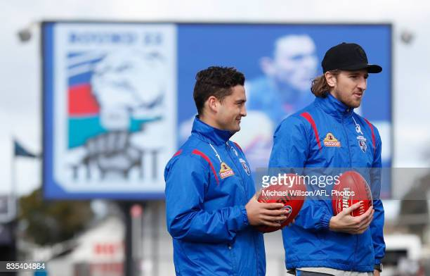 Luke Dahlhaus and Marcus Bontempelli of the Bulldogs look on during the 2017 AFL round 22 match between the Western Bulldogs and the Port Adelaide...