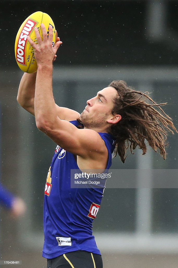 Luke Dahlhaus marks the ball during a Western Bulldogs AFL media/training session at Whitten Oval on June 13, 2013 in Melbourne, Australia.