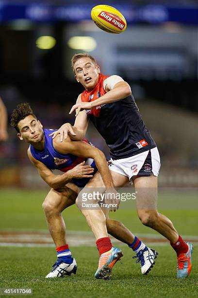 Luke Dahlhaus of the Bulldogs and Bernie Vince of the Demons compete during the round 15 AFL match between the Western Bulldogs and the Melbourne...