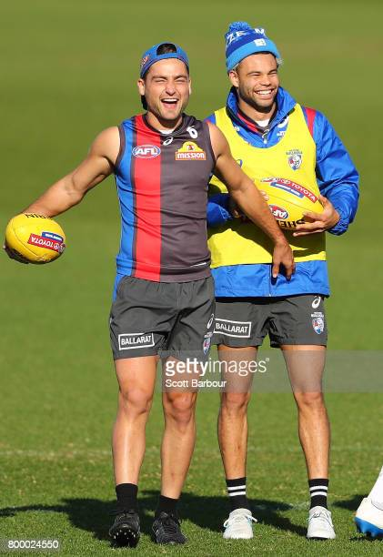 Luke Dahlhaus of the Bulldogs and Jason Johannisen of the Bulldogs laugh during a Western Bulldogs AFL training session at Whitten Oval on June 23...