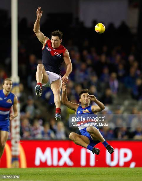Luke Dahlhaus of the Bulldogs and Michael Hibberd of the Demons compete for the ball during the 2017 AFL round 13 match between the Western Bulldogs...
