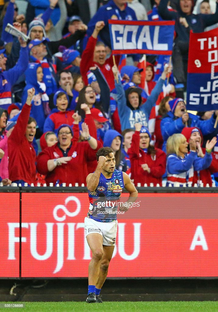 Luke Dahlhaus of the Bulldogs celebrates after kicking a goal at the end of the third quarter during the round 10 AFL match between the Collingwood...