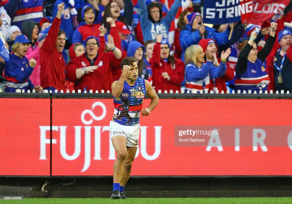 <a gi-track='captionPersonalityLinkClicked' href=/galleries/search?phrase=Luke+Dahlhaus&family=editorial&specificpeople=6892749 ng-click='$event.stopPropagation()'>Luke Dahlhaus</a> of the Bulldogs celebrates after kicking a goal at the end of the third quarter during the round 10 AFL match between the Collingwood Magpies and the Western Bulldogs at Melbourne Cricket Ground on May 29, 2016 in Melbourne, Australia.