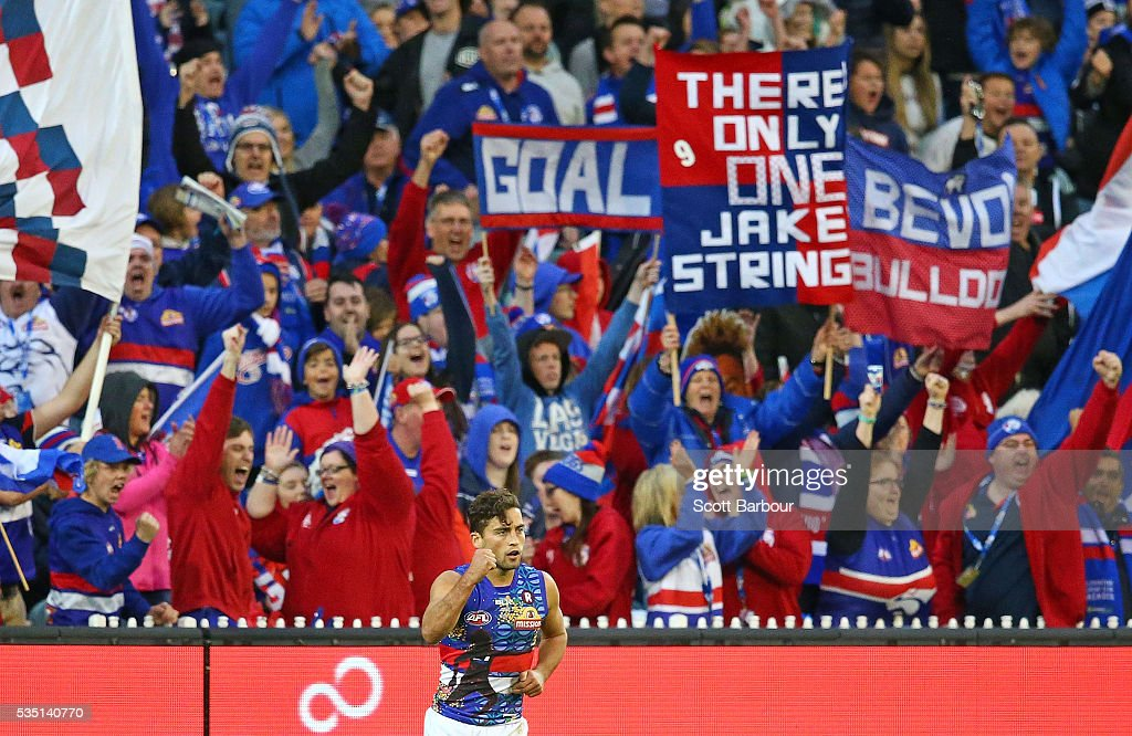 Luke Dahlhaus of the Bulldogs celebrates after kicking a goal at the end of the third quarter during the round 10 AFL match between the Collingwood Magpies and the Western Bulldogs at Melbourne Cricket Ground on May 29, 2016 in Melbourne, Australia.