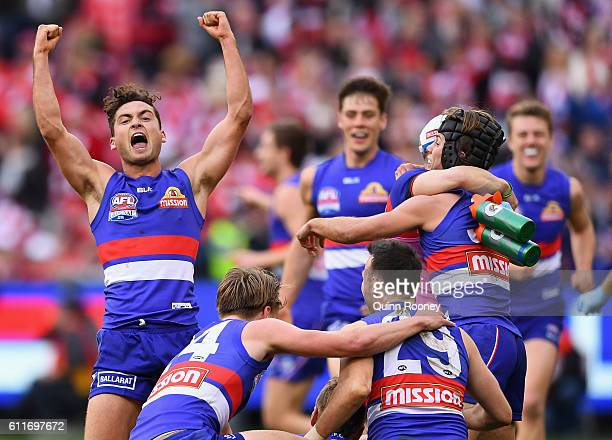 Luke Dahlhaus of the Bulldogs celebrates winning the 2016 AFL Grand Final match between the Sydney Swans and the Western Bulldogs at Melbourne...