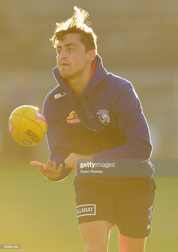 <a gi-track='captionPersonalityLinkClicked' href=/galleries/search?phrase=Luke+Dahlhaus&family=editorial&specificpeople=6892749 ng-click='$event.stopPropagation()'>Luke Dahlhaus</a> of the Bulldogs handballs during a Western Bulldogs AFL training session at Whitten Oval on May 31, 2016 in Melbourne, Australia.