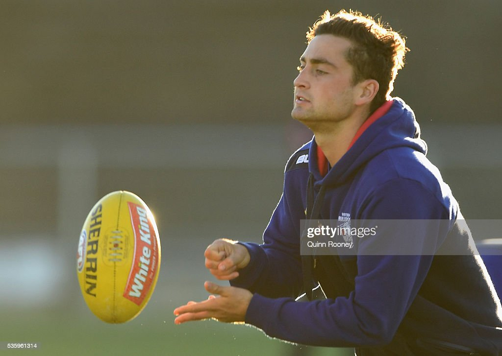 Luke Dahlhaus of the Bulldogs handballs during a Western Bulldogs AFL training session at Whitten Oval on May 31, 2016 in Melbourne, Australia.